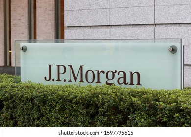 TOKYO, JAPAN - November 15, 2019: A sign for the bank JP Morgan in front of an office building in Tokyo's Marunouchi area.