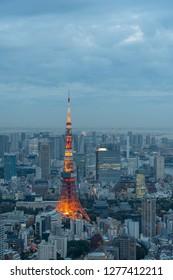 TOKYO, JAPAN - NOVEMBER 16, 2018: Night scene of Tokyo Tower with Tokyo skyline