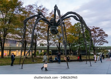 TOKYO, JAPAN - NOVEMBER 16, 2018: Evening scene of Maman, a spider sculpture in front of Roppongi hills tower, Tokyo prefecture, Japan
