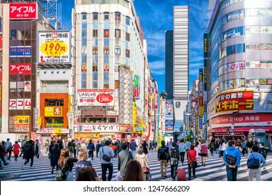 Tokyo, Japan, November 17, 2018: City street with crowd people on zebra crosswalk in Shinjuku area in Tokyo, Japan