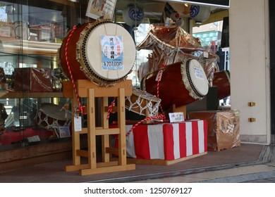 TOKYO, JAPAN - November 17, 2018:Japanese taiko drums and other goods for festivals on display outside a store in Tokyo's Asakusa area.