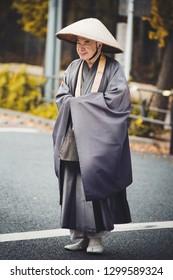 Tokyo, Japan - November 18, 2018: Unidentified Japanese monk on the street in Shibuya, Tokyo, Japan
