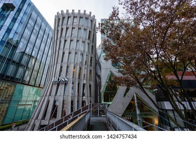 TOKYO, JAPAN - NOVEMBER 18, 2018: Day scene of Boss and Tods shop buildings at Omotesando road, Tokyo prefecture, Japan