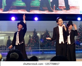 Tokyo, Japan - November 19 2017: Well-dressed Christmas carolers at the Sunshine City mall in Ikebukuro