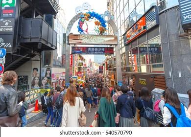 TOKYO, JAPAN - NOVEMBER 20, 2016 Shopping Street at Takeshita Street near Meijijingu/Yoyogi Park, a major tourist attraction in Harajuku District, Tokyo, Japan. Popular people and photographer.