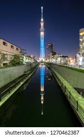TOKYO, JAPAN - November 20, 2018: Tokyo Skytree, Sumida Ward Urban night scene. Tokyo Skytree tower reflections on the canal.