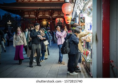 Tokyo, Japan - November 2019. Nakamise is one of the oldest shopping centers in Japan. Since Shogun Tokugawa established Edo Shogunate, the population in Edo grew as well as visitors. Selective focus