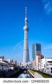 TOKYO, JAPAN - November 21, 2018: A part of Japan Tokyo skytree tower building with blue sky