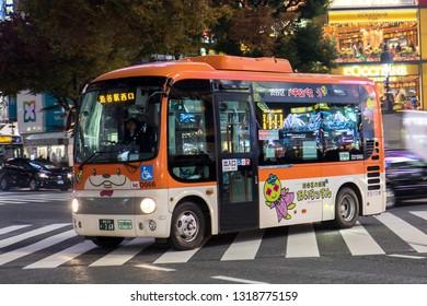 TOKYO, JAPAN - NOVEMBER 22, 2016, Small bus at Shibuya district in Tokyo, Japan. Shibuya Crossing at night.