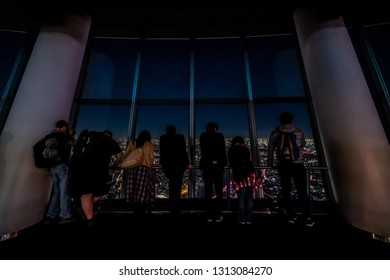 Tokyo, Japan - November 22, 2018: tourists at Tembo Deck observation deck. The Tokyo Skytree is a television broadcasting tower and landmark of Tokyo. Concept of travel and asian metropolis.