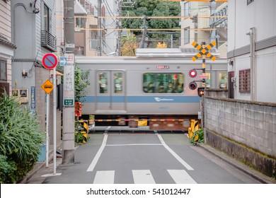 Tokyo, Japan - November 23, 2016: Train crossing Tokyo trains are passing.