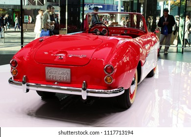 TOKYO, JAPAN - November 23, 2017: View of a red 1961 Datsun Fairlady SPL213, named for the movie 'My Fair Lady', on display at the Nissan Crossing showroom in Ginza Place.