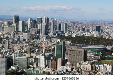 TOKYO, JAPAN - November 23, 2018: Tokyo's skyline seen from Roppongi Hills including the National Stadium being built for the 2020 Olympics and a group of skyscrapers in Shunjuku.
