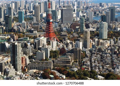 TOKYO, JAPAN - November 23, 2018: Overhead view of the Tokyo's skyline, including the lower half of the Tokyo Tower, with Tokyo Bay in the background.
