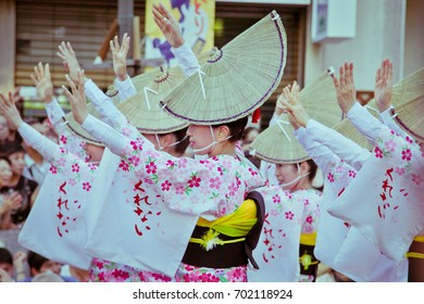 TOKYO, JAPAN - NOVEMBER 26 2012: Japanese performers dancing in the famous Koenji Awa Odori festival. Awaodori is the traditional dance of Tokushima and is now enjoyed throughout Japan.