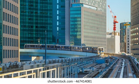 TOKYO, JAPAN - NOVEMBER 27 2015: Cityscape from Yurikamome monorail sky train in Odaiba, the artificial island in Tokyo