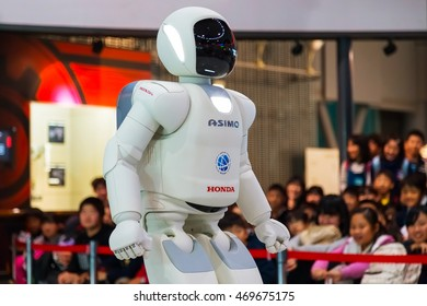 TOKYO, JAPAN - NOVEMBER 27 2015: Asimo, the humanoid robot created by Honda is presented at Miraikan, The National Museum of Emerging Science and Innovation in Odaiba area