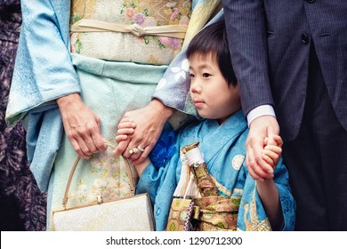 TOKYO, JAPAN - NOVEMBER 28, 2018: Japanese boy with his family celebrate Shichi-Go-San ritual at Shinto shrine. Shichi-Go-Sun is annual festival day in Japan for 3, 5 and 7 years old children.