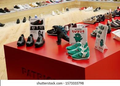 TOKYO, JAPAN - November 28, 2019: Special edition Patrick Godzilla & Chibi Godzilla sneakers in a Patrick store in a Tokyo shopping centre. They are for Godzilla's 65th anniversary.