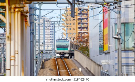 TOKYO, JAPAN - NOVEMBER 29 2015: A local  train arrives at Ikebukuro station