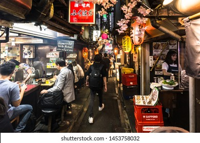 Tokyo, Japan - November 29 2018: People eat out in the famous Yakitori alley in Shinjuku, in the heart of Tokyo, Japan capital city.