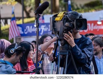 TOKYO, JAPAN - NOVEMBER 3RD, 2018. Japanese media and cameraman crew covering Malaysian Fair event, Shinjuku.