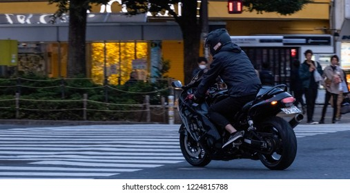 TOKYO, JAPAN - NOVEMBER 3RD, 2018. Man riding a superbike at Shibuya street during the morning hours.