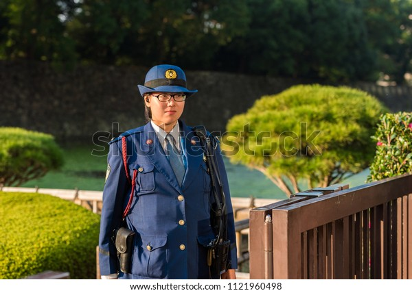 TOKYO, JAPAN - NOVEMBER 7, 2017: Woman police officer in the city park