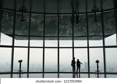 Tokyo, Japan - Oct 9, 2008: People looking at Tokyo skyline from the observatory in Mori Art Museum, Roppongi.
