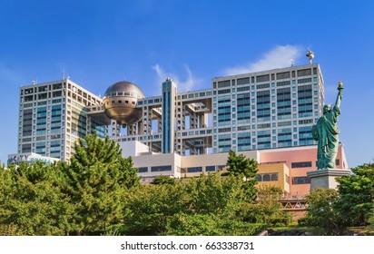 TOKYO, JAPAN - OCTOBER 09, 2015 : The futuristic Fuji TV Building and Statue of Liberty Replica in Odaiba Tokyo Japan