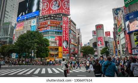 TOKYO, JAPAN - OCTOBER 10, 2016: Crowds of Japanese locals and international tourists crossing at the Shibuya Crossing where the Shibuya Scramble is famous for being the busiest crossing in the world.