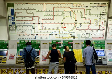 Tokyo, Japan - October 10, 2016: Passengers are buying tickets from vending machines inside Tokyo Station and train Map