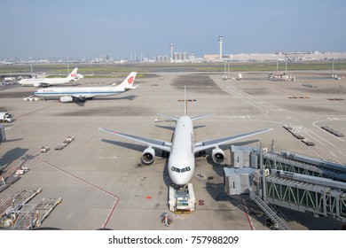 TOKYO, JAPAN - OCTOBER 12, 2017: The aircraft preparing to depart at Haneda International Airport in Tokyo, Japan.