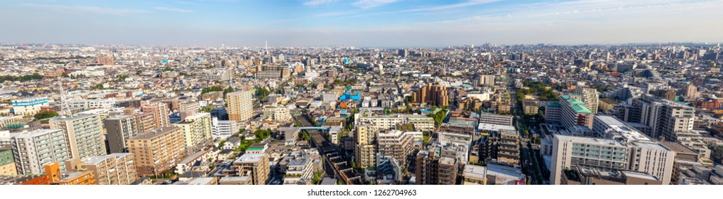 TOKYO ,JAPAN - OCTOBER 12: Panorama of Tokyo city with train railway and Biomass power plant in sky view, OCT 12,2016, Tokyo, Japan. Panorama of Tokyo city with train railway and Biomass power plant