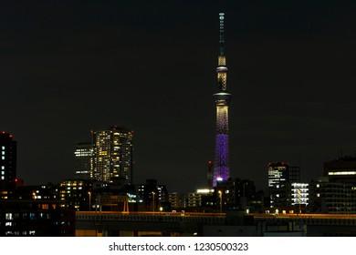 TOKYO ,JAPAN - OCTOBER 12: Tokyo skytree tower in Janpan in night light , OCT 12,2016, Tokyo, Japan.  Tokyo skytree tower in Janpan in night light with brigde and building