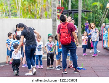 Tokyo, Japan - October 14, 2018: Children and parent are having good time in Kowloon park playground.
