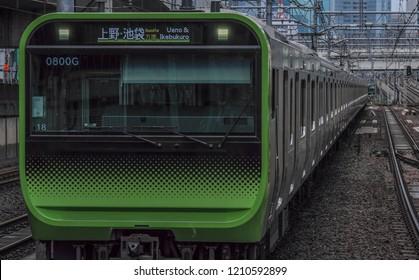 TOKYO, JAPAN - OCTOBER 16TH 2018. Japan Railway Yamanote Line commuter train at Kanda Station.