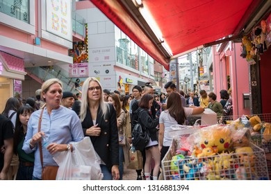 Tokyo, Japan: October 2, 2018:  Thousands of shoppers in the congested part of Tokyo looking at many retail stores.  The population of Tokyo is 9.27 million.