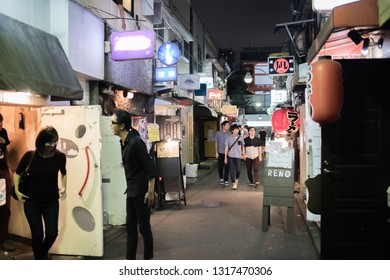 Tokyo, Japan: October 2, 2018:  Nightlife in Tokyo's Shinjuku Golden Gai, which is a section of Tokyo with cozy, tiny bars.  Shinjuku Golden Gai is a popular spot for tourists.