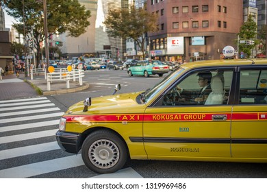Tokyo, Japan:  October 2, 2018:  A taxi driving in Tokyo, Japan.  Japan has a population of 9.2 million.