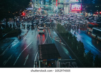 TOKYO, JAPAN -OCTOBER 20, 2017: Busy streets of Shibuya district in Tokyo at night, Japan. Shibuya is one of the shopping and financial districts