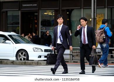 Tokyo, Japan, October 20, 2017: Japan office workers crossing the road in Yaesu area in Tokyo.