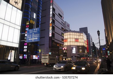 TOKYO, JAPAN - OCTOBER 20 : Cityscape and japanese people drive car on traffic road in dusk time at Shinjuku city of Kanto region on October 20, 2016 in Tokyo, Japan