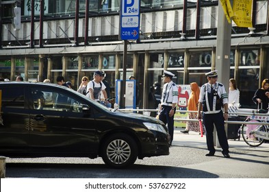 TOKYO, JAPAN - OCTOBER 20 : Japanese police work take care and control car on traffic road at Ameyayokocho market at Ueno district on October 20, 2016 in Tokyo, Japan