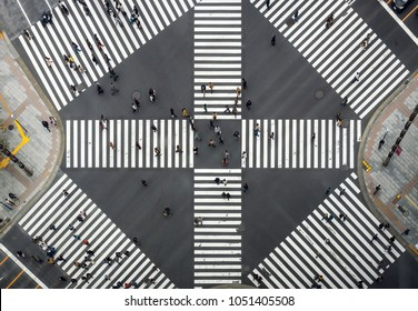 TOKYO, JAPAN - OCTOBER 2017 : Top view of Undefined Japanese people crowd are walking to crosses the street between buildings of Ginza JR station which is district on October 28, 2017 in Tokyo, Japan.