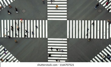 TOKYO, JAPAN - OCTOBER 2017 : Top view of Undefined Japanese people crowd are walking to crosses the street between the buildings of Ginza JR station on October 28, 2017 in Tokyo, Japan.