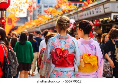 Tokyo, Japan - October 21, 2016: unidentified foreigner tourist wearing kimono, the national tradition costume of Japan walking at Sensoji temple the famous temple in Tokyo, Japan