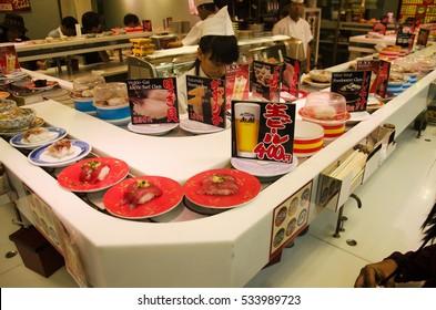 TOKYO, JAPAN - OCTOBER 21 : Japanese people and travelers foreigner eating sushi from sushi conveyor belt at japanese restaurant in Shinjuku city on October 21, 2016 in Tokyo, Japan