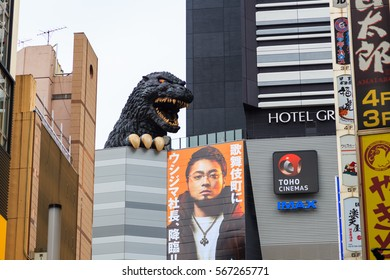 Tokyo, Japan - October 22, 2016: Godzilla statue famous icon monster of Japan on the roof of  Hotel Gracery Shinjuku viewed form Kabuki-cho road, Shinjuku is one of the busiest areas in Tokyo.