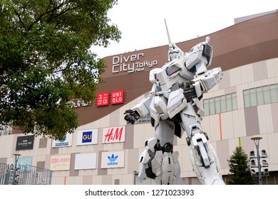 TOKYO, JAPAN - OCTOBER 23, 2018 : A life-sized RX-0 Unicorn Gundam statue on display outside DiverCity Tokyo Plaza in Odaiba, Tokyo. The Unicorn Gundam is anime robot in Gundam series.